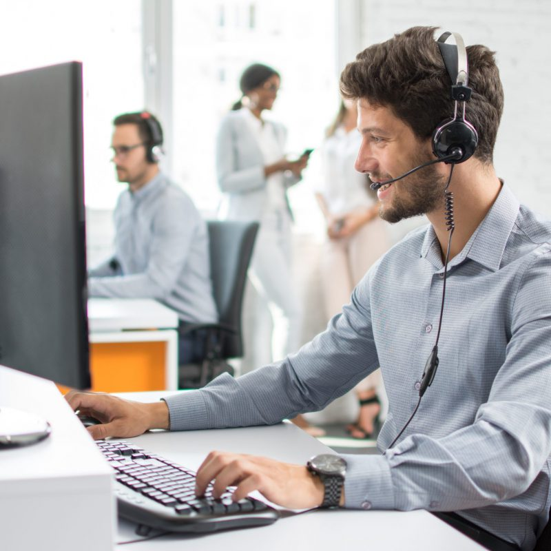 Smiling,Handsome,Customer,Support,Operator,Agent,With,Hands-free,Device,Working